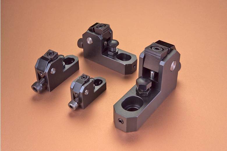 Side clamps provide superior tool access to workpieces